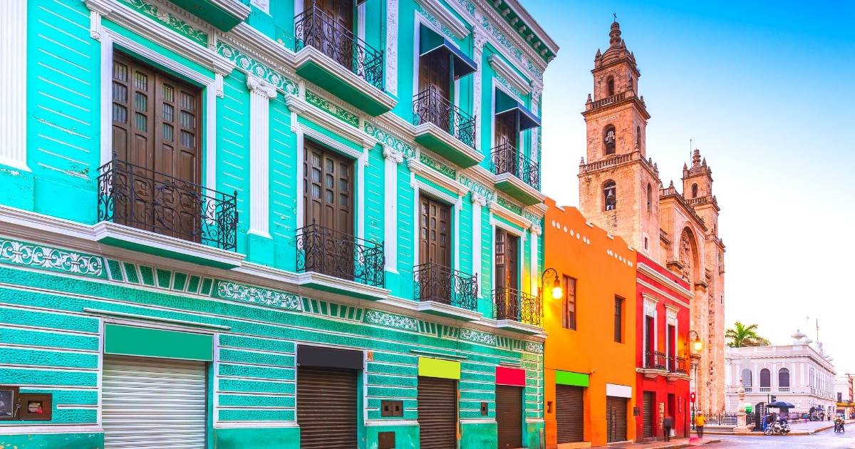 colorful teal, orange & red colonial buildings in merida, mexico