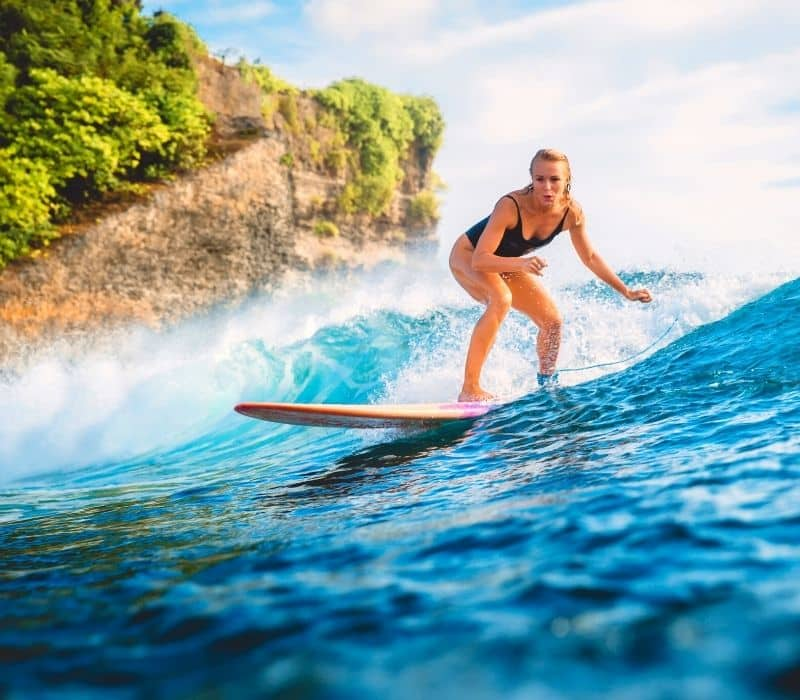 woman surfing in Sayulita, Mexico
