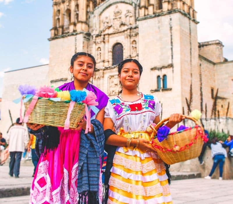 Two girls in traditional Oaxacan clothing