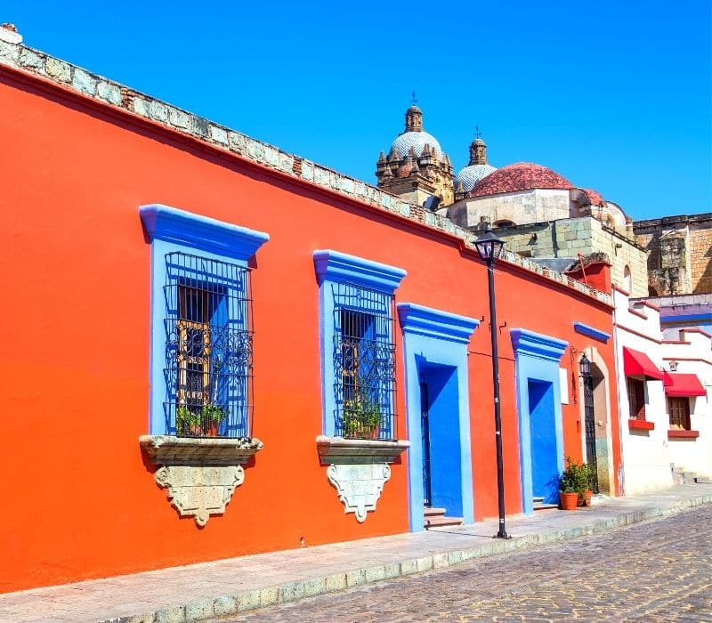 bright orange colonial building in oaxaca mexico - Traveling to Oaxaca