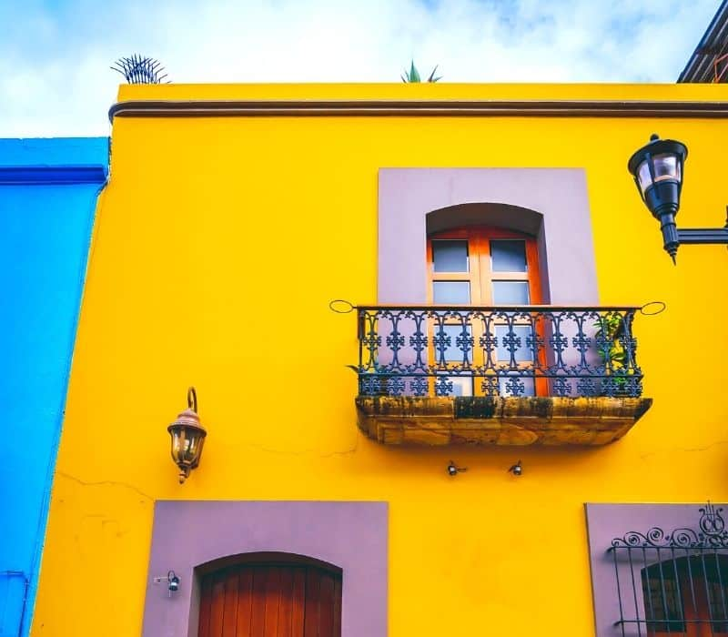 Yellow building with balcony