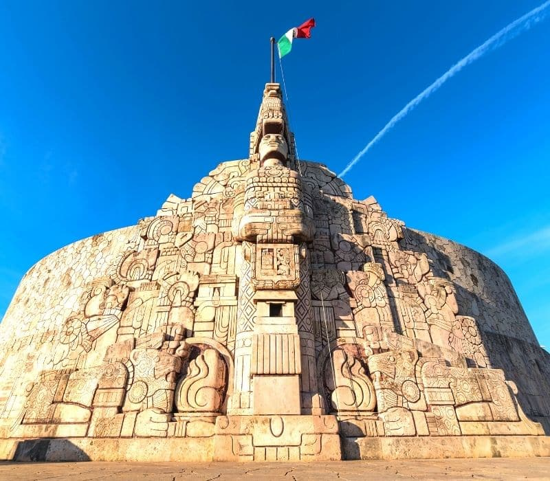 Monumento a la Patria carved stone monument with Mexico's flag on top in Merida, Mexico Yucatan Peninsula