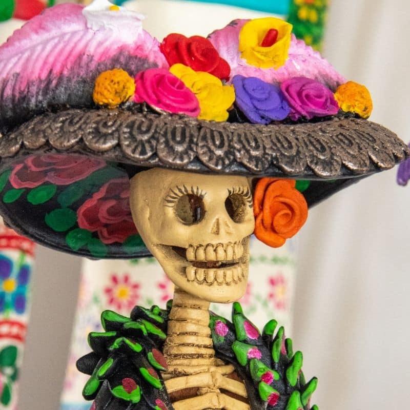 La Catrina doll - skeletal woman in fancy feathered hat | oaxaca day of the dead in mexico