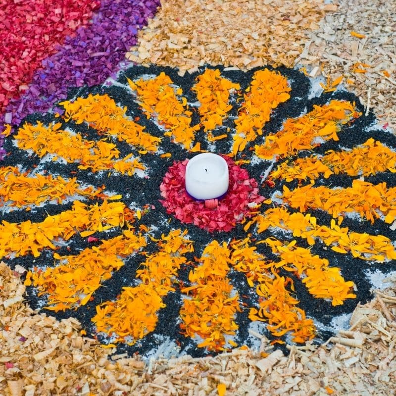 flower petals rearranged into the shape of a flower as art | oaxaca day of the dead in mexico