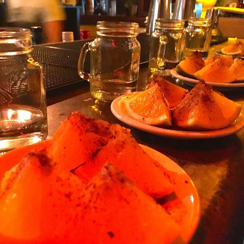 Mezcal with orange slices on the side