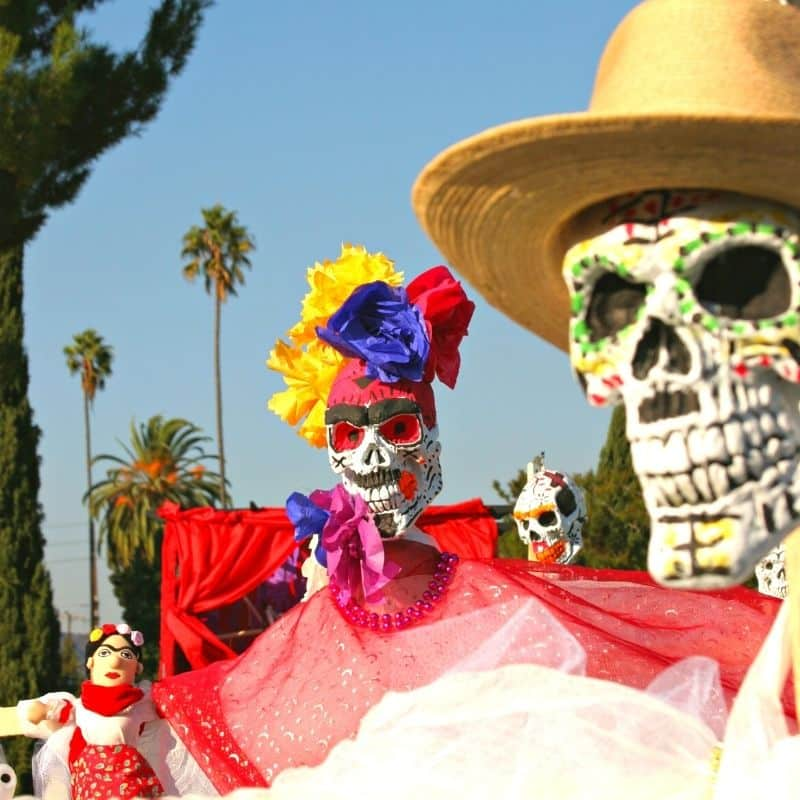 parade with oversized human skeleton dolls | oaxaca day of the dead in mexico