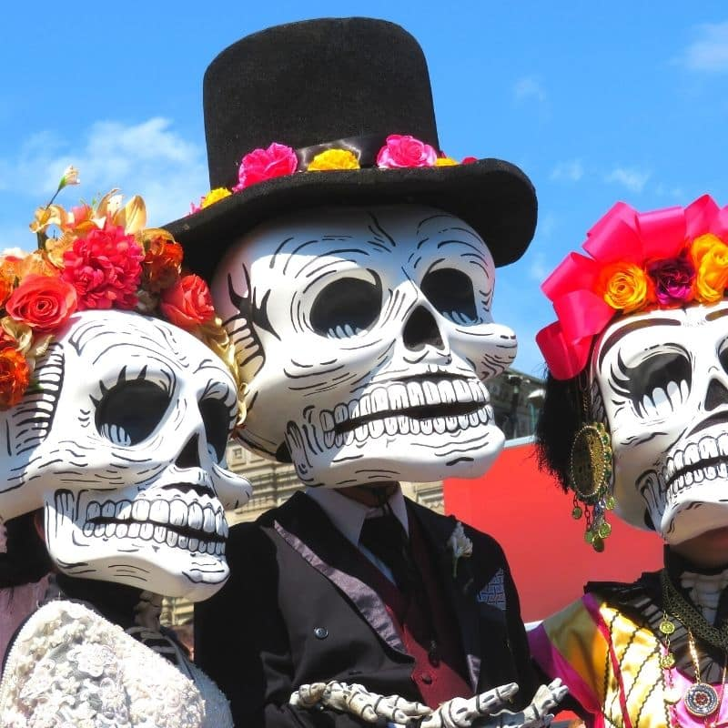 over-sized masks of skeleton faces | oaxaca day of the dead in mexico