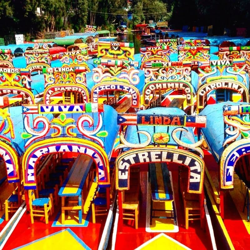 colorful trajineras, gondola-style boats, at Xochimilco.