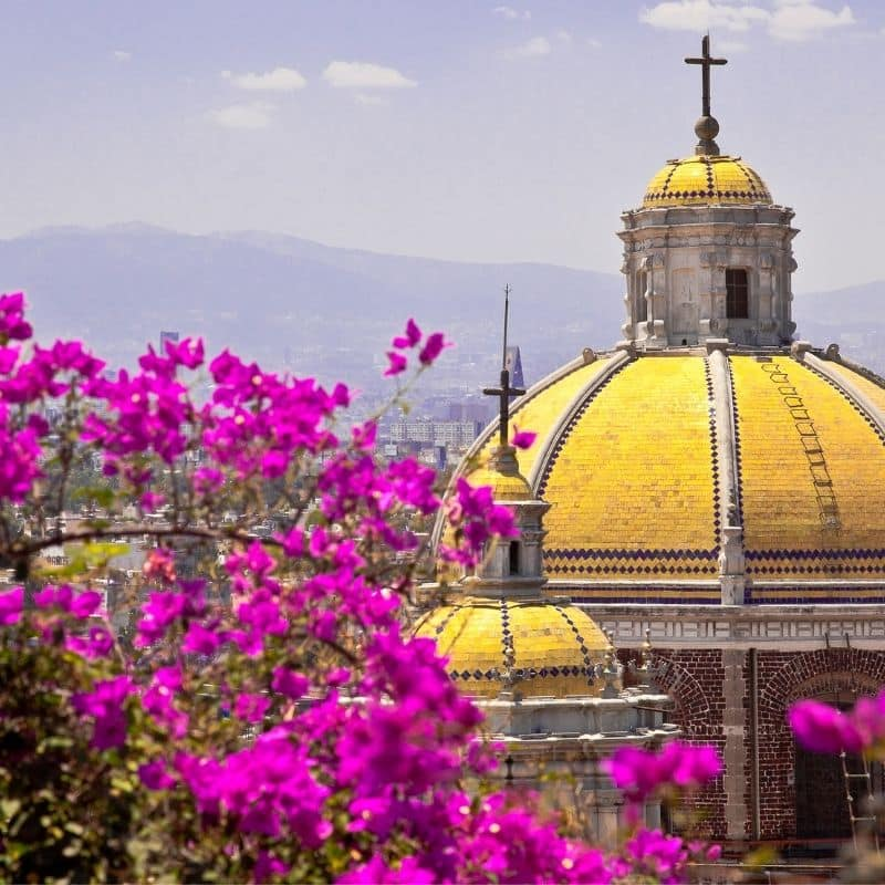 yellow domed church building in Mexico City historic center