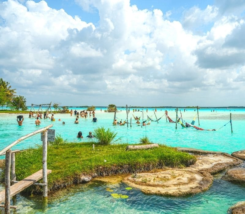 hammocks in the blue wasters of bacalar lagoon mexico