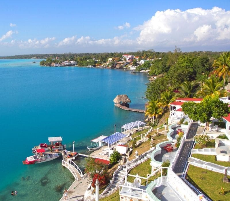 houses on the lake in bacalar lagoon mexico