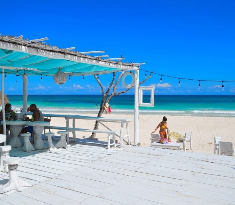 Coco Tulum beach club, known for its instagrammable, shabby chic esthetic and white beach swings