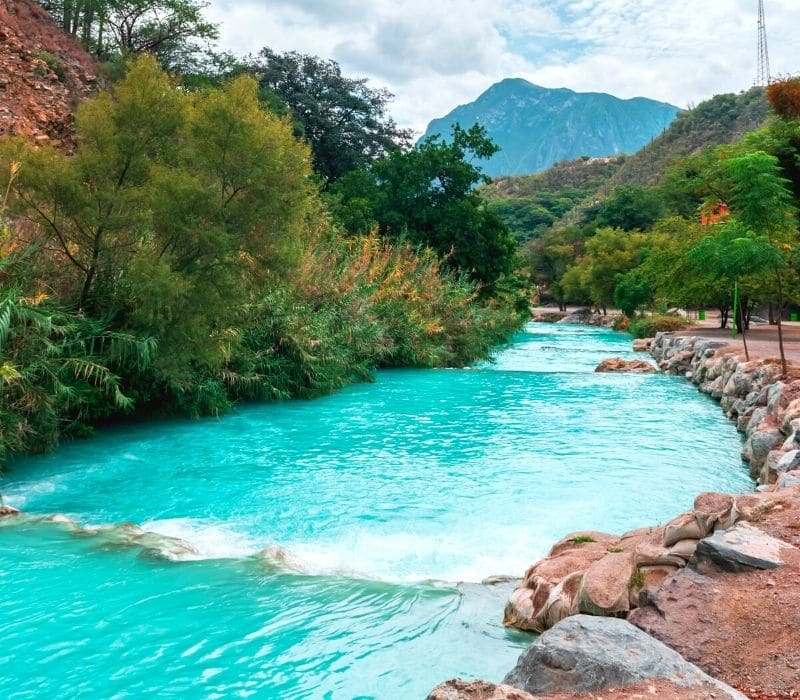 blue river water in a natural mountain setting - Visit Las Grutas Tolantongo
