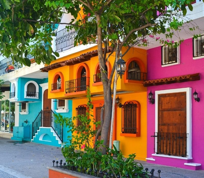 colorful blue, orange and pink houses | things to do in puerto vallarta mexico