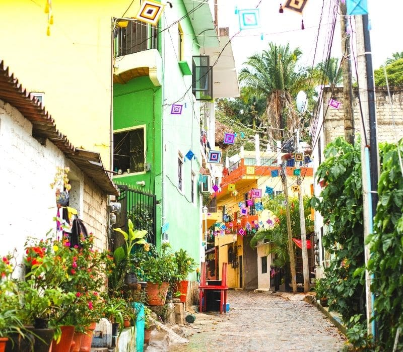 colorful buildings and cobble stone streets in beach town of San Pancho, Mexico | things to do in puerto vallarta mexico