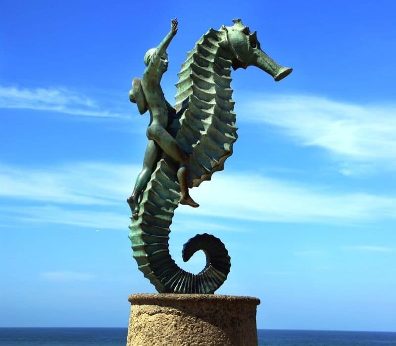 boy on the seahorse sculpture on the malecon walkway | things to do in puerto vallarta mexico