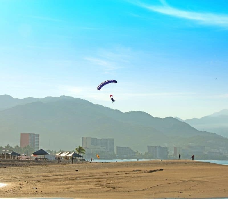 skydiving or paragliding back down to the beach | things to do in puerto vallarta mexico