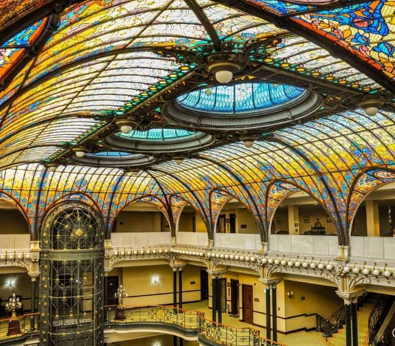 vintage building with cage elevator and stained glass ceiling | Mexico City historic center