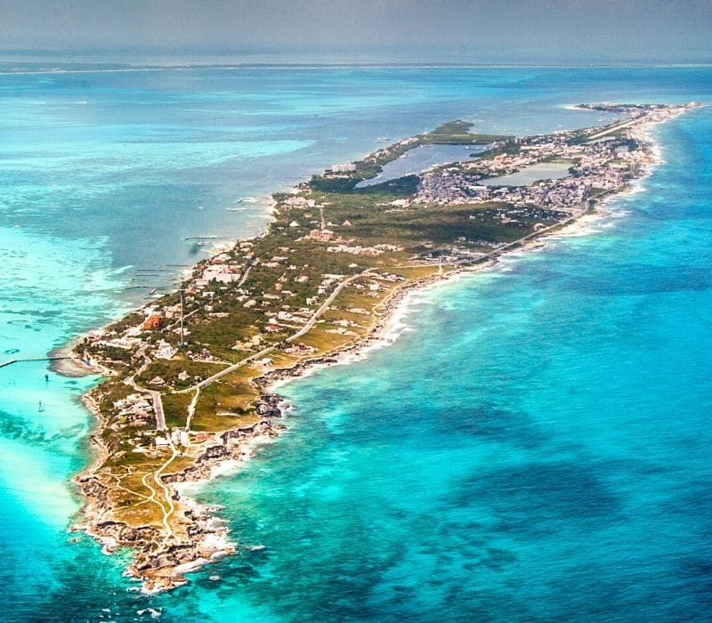 areial shot of isla mujeres, one of the safest cities in mexico, located in the blue waters of the caribbean sea
