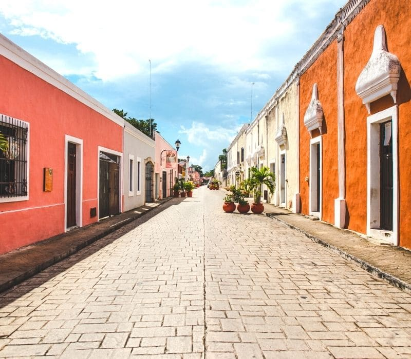 colorful buildings and colonial architecture on the Calzada de los Frailes in valladolid, mexico