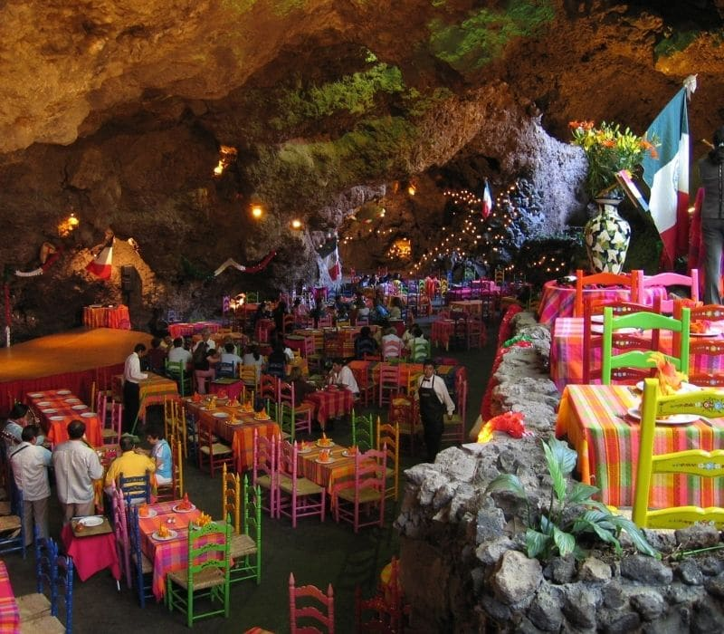 colorful chairs at a restaurant in a cave near mexico city called La Gruta | 4 day mexico city itinerary