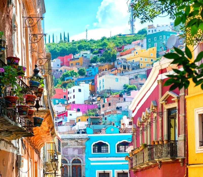 brightly colored home and buildings in the colorful colonial town of Guanajuato City, Guanajuato, Mexico, located in central Mexico, and a safe place for female solo Mexico travel