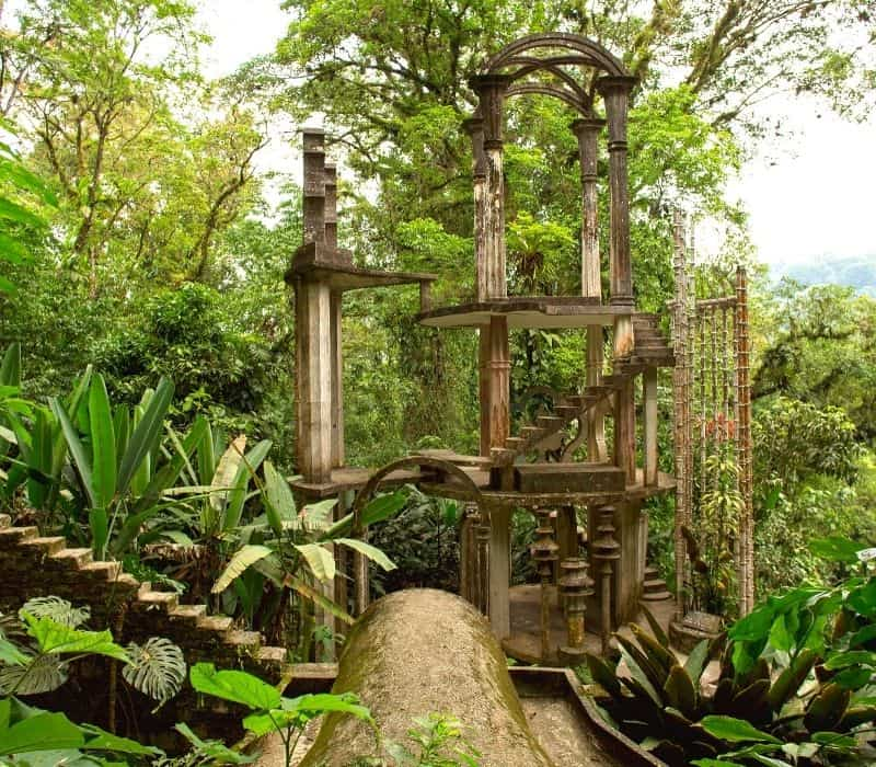 large surrealist sculpture with arches and stairways in the jungle at Las Pozas or Xilitla, one of the most unique places to visit in mexico