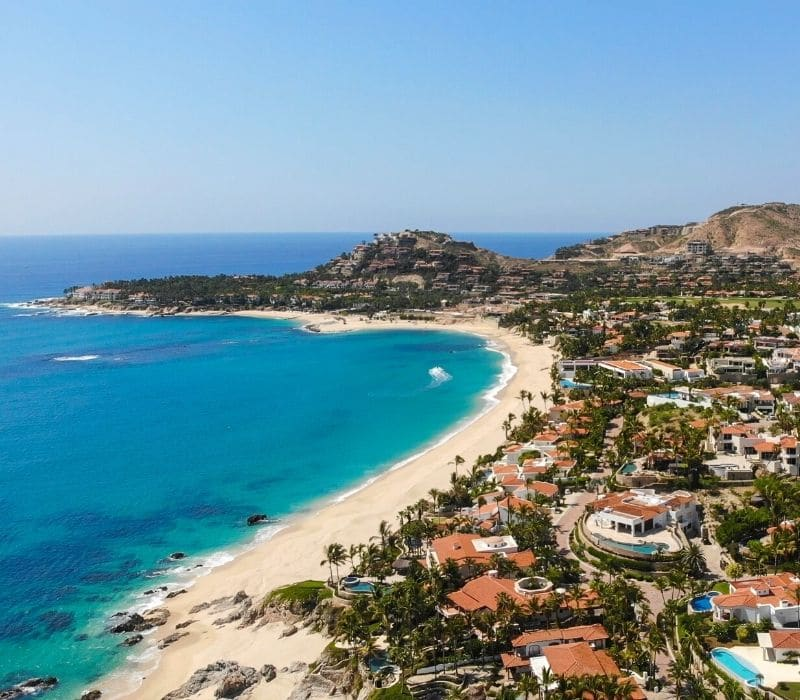beautiful blue water and homes on the beach in san jose del cabo, one of the Best Mexican Beach Towns