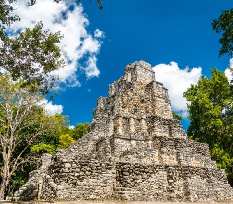 tall stone structure at Muyil Mayan Ruins in the Yucatan, Tulum