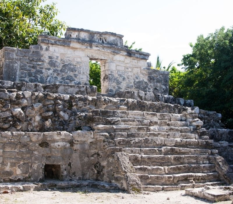 stone structures at Xcaret Mayan Ruins in the Yucatan