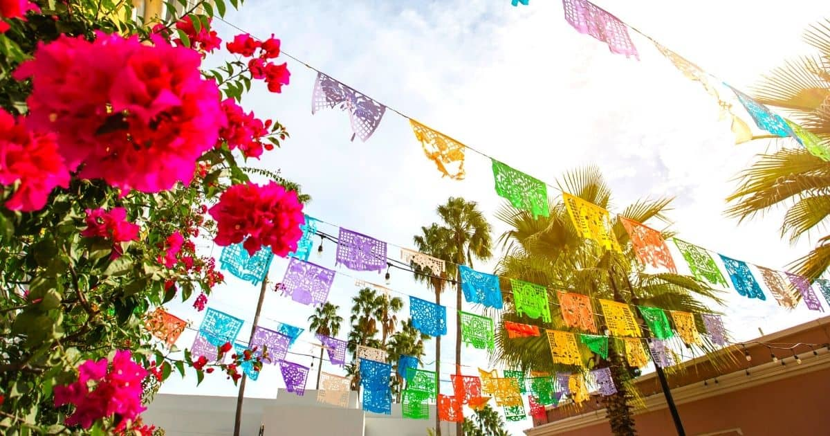colorful paper flags and pink flowers in one of the Safest Cities in Mexico